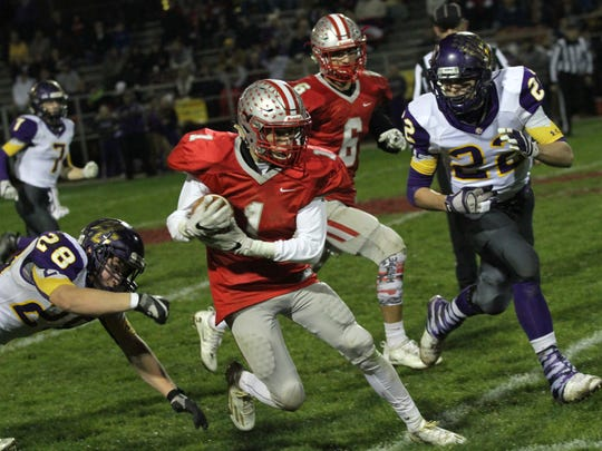 Shelby's Brady Hill cuts through the Bloom-Carroll defense while playing at home  on Friday night.