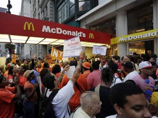 Fast-food workers demonstrate outside a McDonald's in New York in August 2013, demanding a raise in the minimum wage.