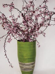 Stalks of spring-flowering shrubs, trees look great in vase. Although it is tempting to go for the ones with lots of open blooms, it is better to look for those branches or twigs that still have a fair number of closed buds. The buds will open after you cut them, and you will have a much-longer blooming time. When you are cutting these, always cut at a 45-degree angle, which gives the stems more surface for gathering water. If you make a few slits in the bottoms of the cut, that also will help with the water absorption, and the blooms will last longer.