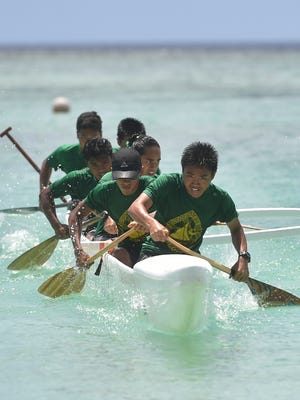 The John F. Kennedy Islanders Manhoben Lalahi team pushes for the finish during their Independent Interscholastic Association of Guam and the Guam Kayak and Canoe Federation Paddling Series 500-meter race at Matapang Beach in Tumon on May 20, 2017.