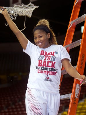NMSU senior guard Shanice Davis celebrates the Aggies' back to back Western Athletic Conference regular season women's basketball championship by twirling the net she just cut down Saturday afternoon at he Pan American Center.