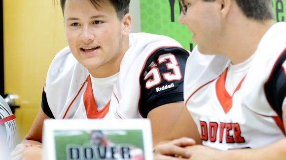 Dover's Chase Heath, left, and Shad Murphy talk to reporters at the York-Adams Football Media Day at the York Newspaper Company Tuesday, Aug. 1, 2017. Heath has been selected to play in the Pennsylvania State Football Coaches Association East-West All-Star Football Game. Bill Kalina photo