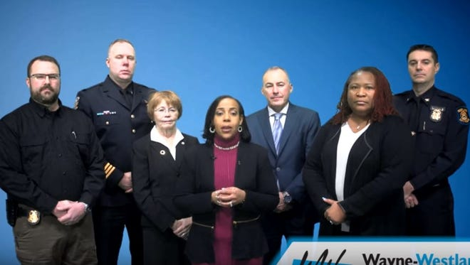 Shelley Holt, superintendent of Wayne-Westland schools, speaks in a video posted on the school district's website. She is surrounded by other community members, including the mayors and police chiefs of Wayne and Westland, the WWCS board president and a lieutenant from the Inkster Police Department.