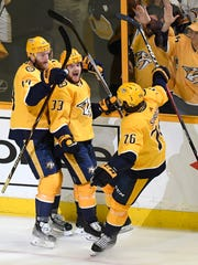 Predators right wing Viktor Arvidsson (33) celebrates