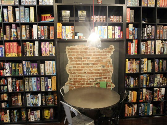 Shelves of board games cover the wall inside Rook; a board game parlor/bar/restaurant in the Over the Rhine. The Enquirer/Patrick Reddy