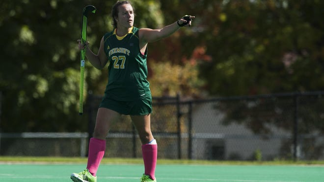 Landon Warren pumps her fist after the University of Vermont field hockey team scores a goal in an early season game at Moulton Winder Field.