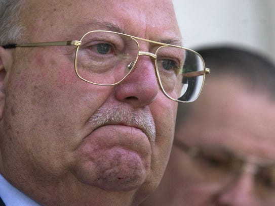 Mayor Charlie Robertson holds back tears as he announces