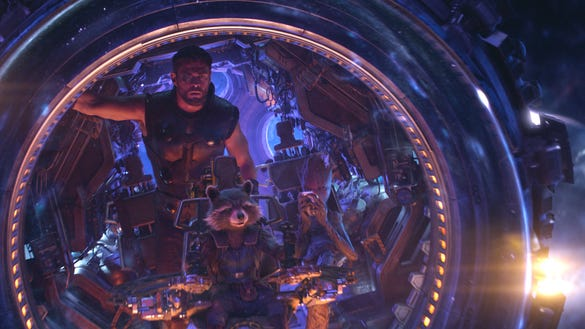 """Thor (Chris Hemsworth), Rocket (voiced by Bradley Cooper) and Groot (voiced by Vin Diesel) in """"Avengers: Infinity War."""""""