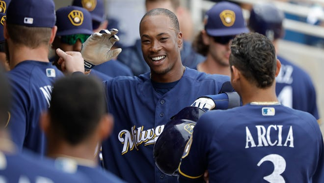 The Milwaukee Brewers' Keon Broxton celebrates after scoring during a spring training game against the San Francisco Giants on March 22 in Phoenix.