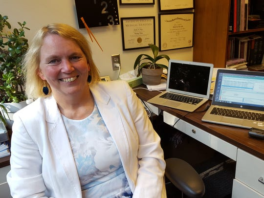 Dr. Martha Nance, an expert in genetics, poses for a photo in her office at the Struthers Parkinson's Center in Minneapolis on June 2, 2017.