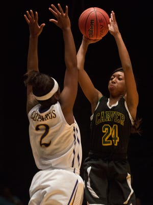 Carver's Dasia Rudolph (24) shoots over Blount's Shatoria Pettway (2) during the AHSAA Class 6A South Regional Tournament on Friday, Feb. 13, 2015, in Dothan, Ala.