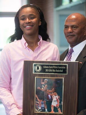 Jeff Davis' Jasmine Walker receives the Miss Basketball Award during the Alabama Sports Writer Association Athletes of the Year Miss and Mr. Basketball banquet on Wednesday, April 6, 2016, in Montgomery, Ala.