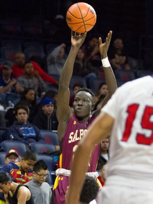 Tucson Salpointe's Majok Deng shoots the ball during the MLK Basketball Classic at McKale Center on Monday January 16, 2016.