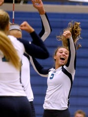 Siegel's  Julia Wheeler (5) celebrates a point against Brentwood during a set. Siegel lost to Brentwood 3 sets to 1 at Siegel High School, on Tuesday, Aug. 15 ,2017.