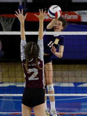 Lily Felts of Berean Christian attacks against South Greene during the TSSAA Division I-A State Volleyball Championship.