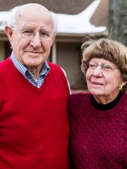 Dr. Robert Webster and his wife, Marjorie, stand outside