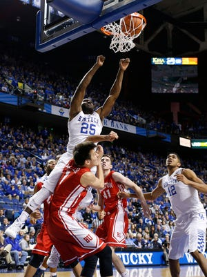 Kentucky guard Dominique Hawkins takes an alley oop dunk over Boston University forward Nick Havener in the second half.  The University of Kentucky Men's Basketball team hosted Boston University, Friday, Nov. 21, 2014 at Rupp Arena in Lexington. Photo by Jonathan Palmer, Special to the CJ