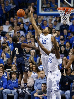Kentucky forward Karl-Anthony Towns, back, blocks a shot by Montana State guard Michael Dison in the first half. The University of Kentucky Men's Basketball team hosted Montana State University, Sunday, Nov. 23, 2014 at Rupp Arena in Lexington. Photo by Jonathan Palmer, Special to the CJ