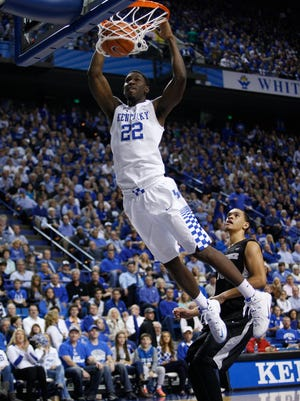 Kentucky forward Alex Poythress slams down two of his 6 in the second half. 