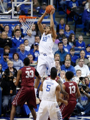 Kentucky forward Karl-Anthony Towns, dunks in the first half. The University of Kentucky Men's Basketball team hosted Eastern Kentucky University, Sunday, Dec. 07, 2014 at Rupp Arena in Lexington. Photo by Jonathan Palmer, Special to the CJ