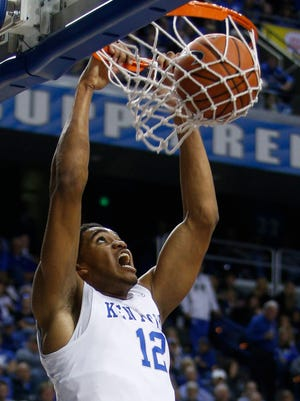Kentucky forward Karl-Anthony Towns dunks in the first half. The University of Kentucky hosted the University of Pikeville   , Sunday, Nov. 02, 2014 at Rupp Arena in Lexington. Photo by Jonathan Palmer, Special to the CJ