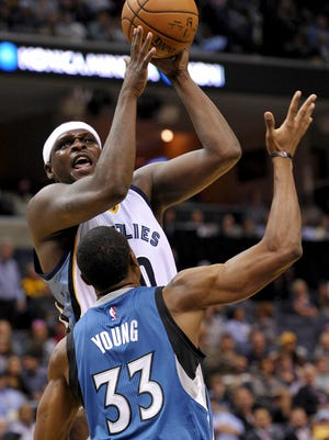 Memphis forward Zach Randolph shoots over Minnesota Timberwolves forward Thaddeus Young (33) in the first half of Wednesday's game.