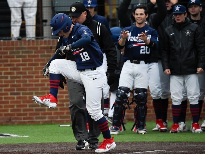 Vanderbilt right fielder Pat DeMarco (18) stomps on