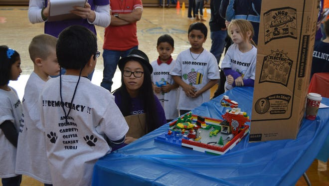 Hannah Ho of the Hackbots talks with the LEGO Rockers from Longacre Elementary.