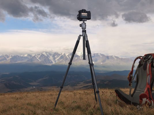 The Aukey CP-T06 travel tripod comes with removal metal spikes for better stability outdoors.