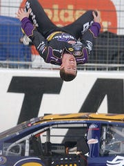 Carl Edwards does a backflip from his car after winning the NASCAR Busch Aaron's 312 at Atlanta Motor Speedway in Hampton, Ga., Saturday, March 19, 2005.