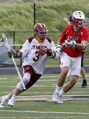 Ithaca's Matt Pagliaro (3) takes the ball up the field