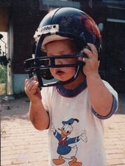 Andrew Luck's first football helmet? Here he sports the helmet of the Frankfurt Galaxy, the NFL Europe team his dad ran during his youth.