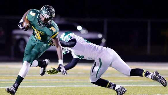 Reynolds' R'mani Lynch tries to avoid the tackle of