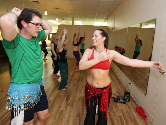 Instructor Cassandra Rose works with Statesman Journal reporter Tom Mayhall Rastrelli during an advanced belly dancing class on Thursday, Sept. 10, 2015, in Salem.