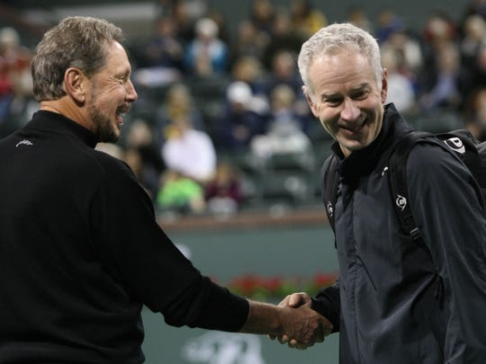 BNP Paribas Open owner Larry Ellison (left) shakes hands with tennis legend John McEnroe during John McEnroe's Challenge for Charity tennis event March 1, 2014, at the Indian Wells Tennis Garden.