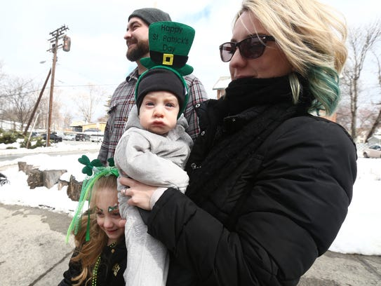 From left, Alex, Isabella, Alex Junior and Rebecca Merritt of Beacon take in the St. Patrick's Day Parade of Green in Beacon on March 10, 2018.
