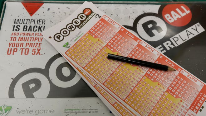 Powerball lottery tickets are ready to be filled out at a store in Richmond, Va., Wednesday, Feb. 19, 2014. The estimated Powerball lottery jackpot is $400 million.   (AP Photo/Steve Helber)