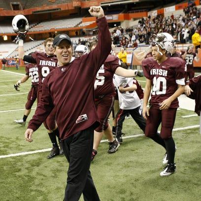 Aquinas' head coach Chris Battaglia, left, and the