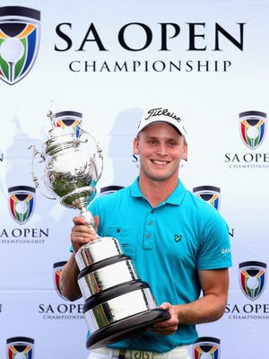 Morten Orum Madsen of Denmark poses with his trophy after winning the South African Open Championship.