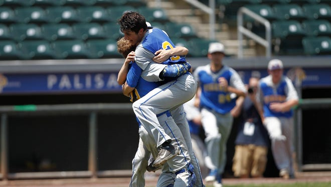 North Salem pitcher Danny Capra (3) celabrates with teamates after their 9-4 win over Tuckahoe in the Class C sectional baseball game at Palisades Credit Union Park in Pomona on Saturday, May 28, 2016.  North Salem won 9-4.