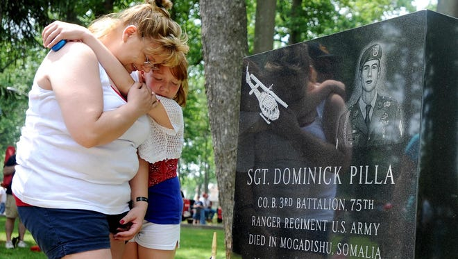 On May 30, 2011, Mary Jenkins, originally from Millville, and her daughter Skyler visit a monument in memory of her cousin/best friend U.S. Army Ranger Sgt. Dominick Pilla of Vineland, who was killed in action in Mogadishu, Somalia, in 1993.