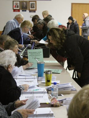 Voters line up at the Elks Lodge in Grinnell to vote in the Grinnell-Newburg School Bond election. The bond failed to reach the 60 percent yes vote needed to pass.