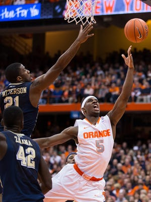 C.J. Fair of the Syracuse Orange sneaks in a lay up past Lamar Patterson of the Pittsburgh Panthers.