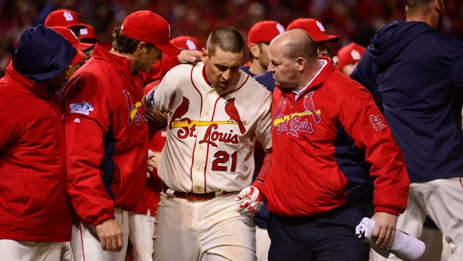 A hobbled Allen Craig had to be helped off the field after scoring the winning run.