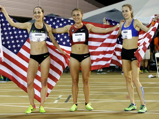 From left, Shannon Rowbury, Shelby Houlihan and Molly Huddle hold U.S. flags after running the women's 5,000 meters at the U.S. Track and Field Championships on Friday. Houlihan won the race, Rowbury finished second, and Huddle third.
