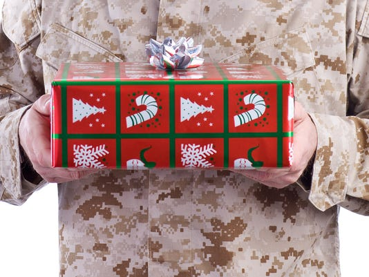 Marine Holds a Christmas Gift