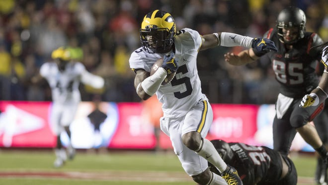 Michigan linebacker Jabrill Peppers runs for an apparent touchdown in the first quarter. The play was called back due to penalty.