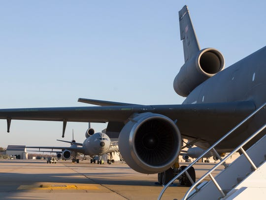 KC10's stand lined up on tarmac at McGuire. Congressman