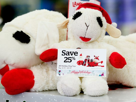 A stuffed toy with a 25 percent off advertisement is