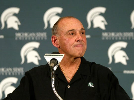 Michigan State football coach John L. Smith addresses the media on  Nov. 1, 2006, in East Lansing after the announcement that Smith would not return next year as Michigan State's football coach but would complete the rest of the season.